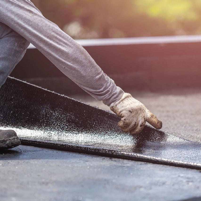 contractor applying modified bitumen roofing