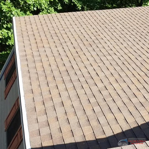 A Picture of a Brownish Shingle Roof.