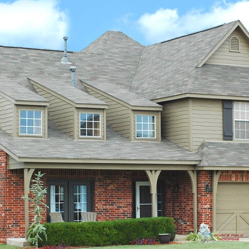 A Picture of a House with a New Roof.