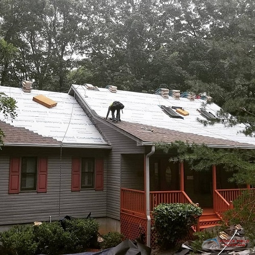 A Picture of One Roofer Working On a Shingle Roof.
