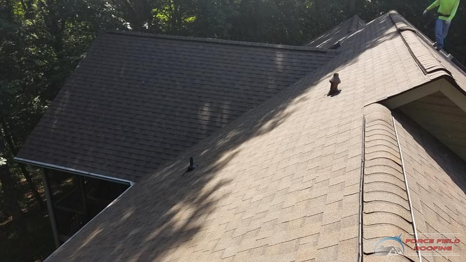 A Picture of a Roofer On a Shingle Roofing System.
