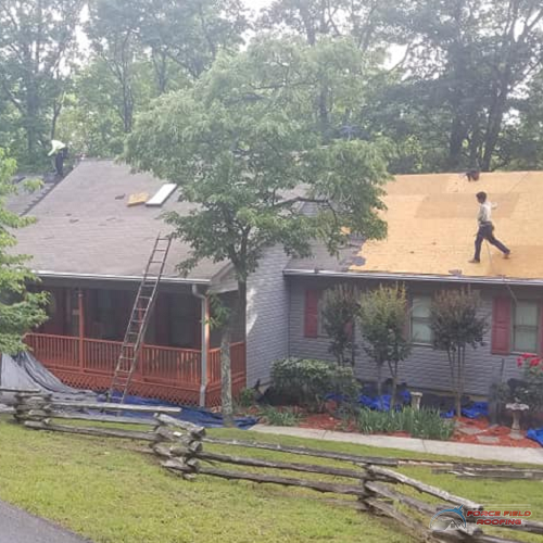 A Picture of Roofing Contractors Working On Roof Repair.
