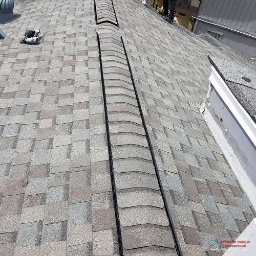 A Picture of a Shingle Roof That's Been Repaired.